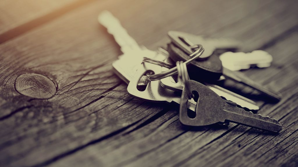 Keys made of steel showcased on wood for post featured image