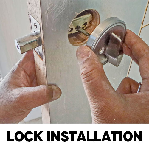 Commercial Locksmith installing a new lock